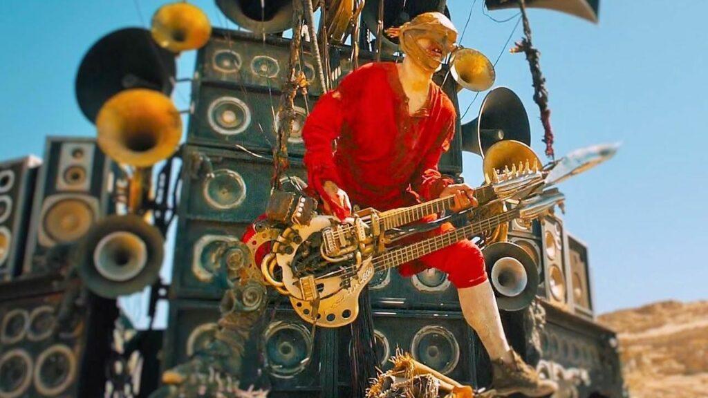 Гитарист с огнеметом Безумный Макс Дорога Ярости